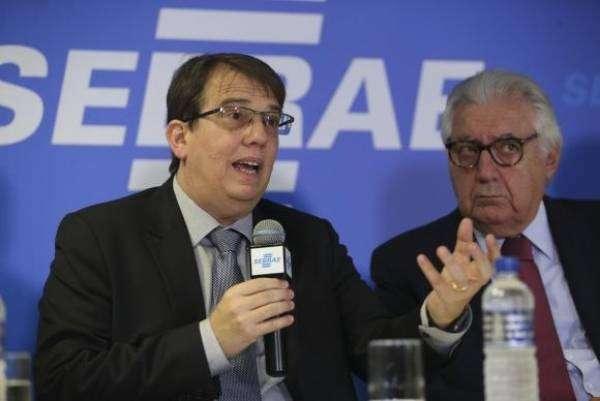 O diretor de Áreas de Operações do BNDES, Ricardo Ramos,e o presidente do Sebrae, Afif Domingos. Foto: José Cruz/Agência Brasil
